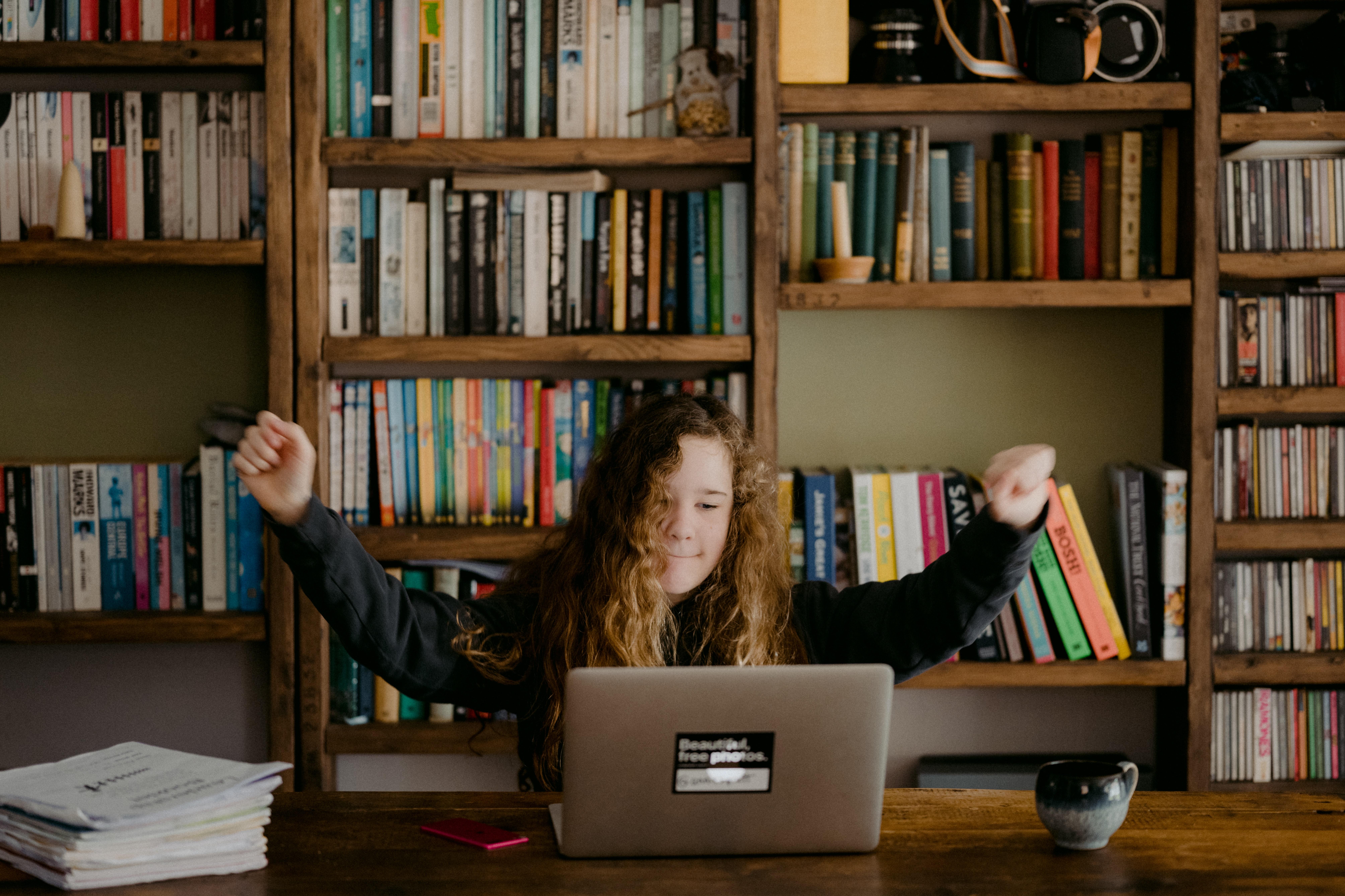 Girl studying on laptop