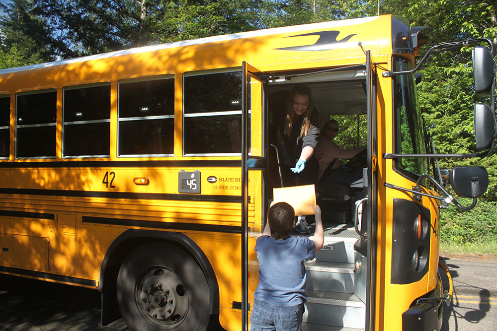 Buses deliver kits to students at their regular bus stops